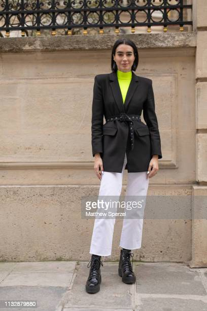Brittany Xavier is seen on the street attending Roger Vivier during Paris Fashion Week AW19 wearing black blazer neon turtleneck white pants and...