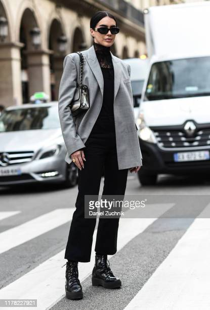 Brittany Xavier is seen wearing a gray jacket black Giambattista Valli blouse and black pants outside the Giambattista Valli show during Paris...