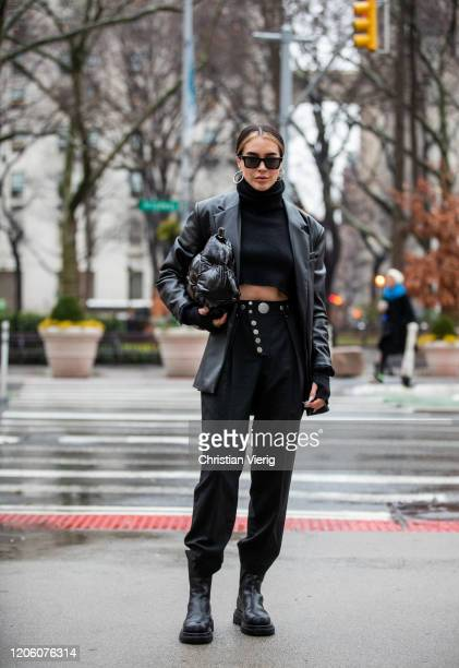 Brittany Xavier is seen wearing black leather jacket, bag, cropped turtleneck, black pants outside Khaite during New York Fashion Week Fall / Winter...