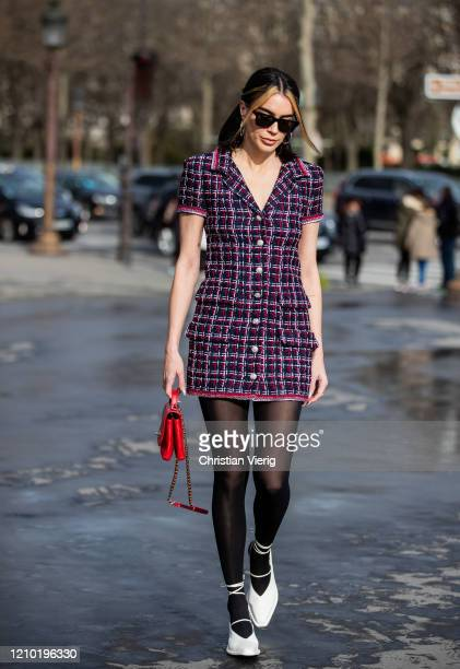 Brittany Xavier is seen wearing checkered dress, sheer tights outside Chanel during Paris Fashion Week - Womenswear Fall/Winter 2020/2021 : Day Nine...