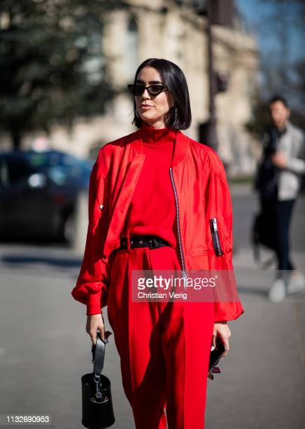 Brittany Xavier is seen wearing red pants turtleneck jacket outside Unravel Project during Paris Fashion Week Womenswear Fall/Winter 2019/2020 on...