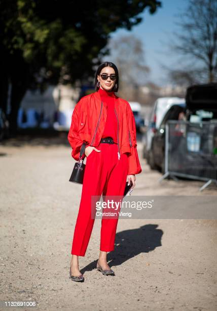 Brittany Xavier is seen wearing red pants, turtleneck, jacket outside Unravel Project during Paris Fashion Week Womenswear Fall/Winter 2019/2020 on...