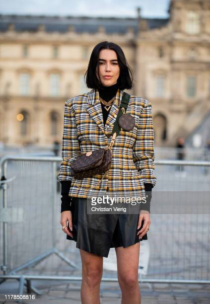 Brittany Xavier seen wearing checkered blazer black skirt fanny bag outside Louis Vuitton during Paris Fashion Week Womenswear Spring Summer 2020 on...