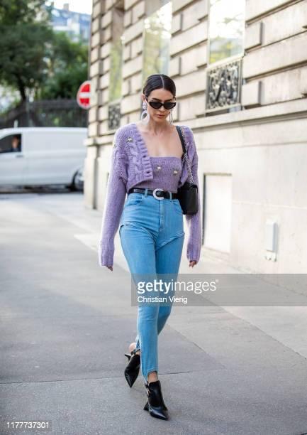 Brittany Xavier seen wearing denim jeans cropped cardigan outside Alessandra Rich during Paris Fashion Week Womenswear Spring Summer 2020 on...