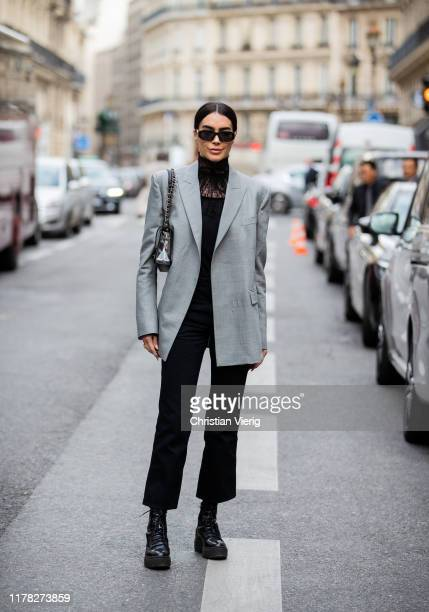 Brittany Xavier seen wearing grey blazer black pants sheer turtleneck outside Giambattista Valli during Paris Fashion Week Womenswear Spring Summer...