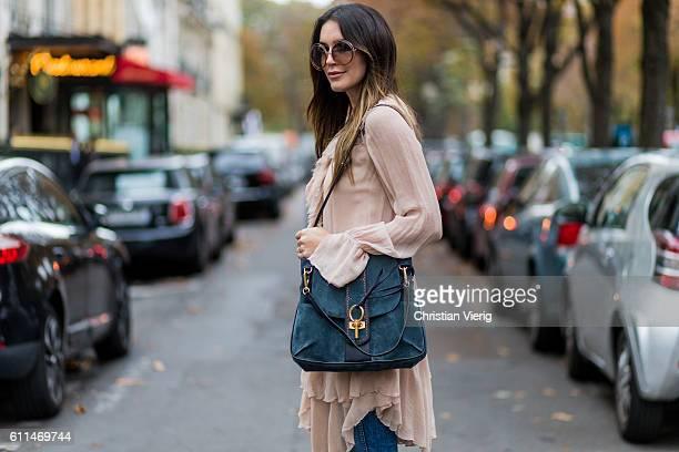 Brittany Xavier wearing a chloe dress denim jeans Chloe sunglasses and Chloe Lexa bag outside Chloe on September 29 2016 in Paris France