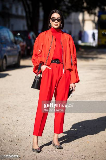 Brittany Xavier wearing a red sweater red pants red jacket silver shoes and black bag is seen outside Unravel Project on Day 3 Paris Fashion Week...