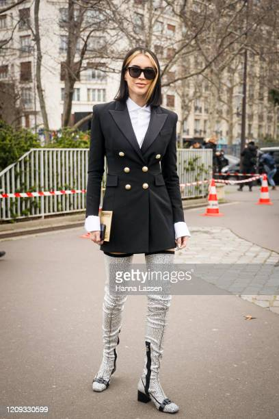 Brittany Xavier wearing black Balmain blazer, silver knee high boots and sunglasses outside the Balmain show during the Paris Fashion Week Womenswear...