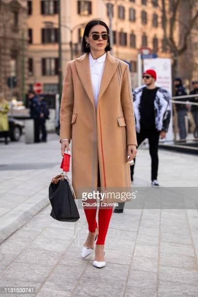 Brittany Xavier wearing camel coat and red pants is seen outside Sportmax on Day 3 Milan Fashion Week Autumn/Winter 2019/20 on February 22 2019 in...