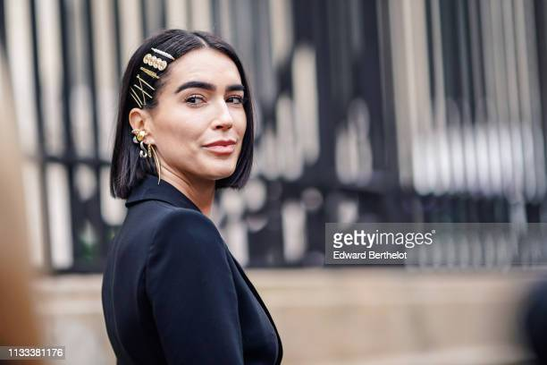 Brittany Xavier wears hair clips earrings a black blazer jacket outside Altuzarra during Paris Fashion Week Womenswear Fall/Winter 2019/2020 on March...