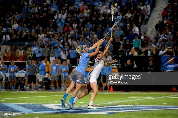 Brittney Coppa of the University of North Carolina reaches for the ball against Taylor Cummings of the University of Maryland during the 2013 NCAA...