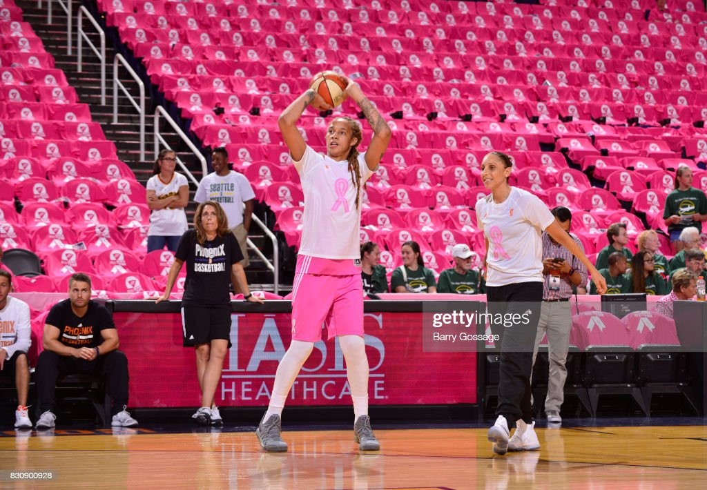 Brittney Griner #42 and Diana Taurasi #3 of the Phoenix Mercury warm up before the game against the Seattle Storm on August 12, 2017 at Talking Stick Resort Arena in Phoenix, Arizona.