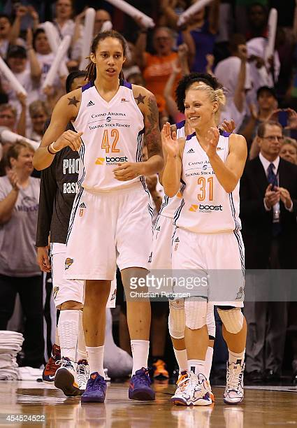 Brittney Griner and Erin Phillips of the Phoenix Mercury celebrate after defeating the Minnesota Lynx 9678 in game three of the WNBA Western...