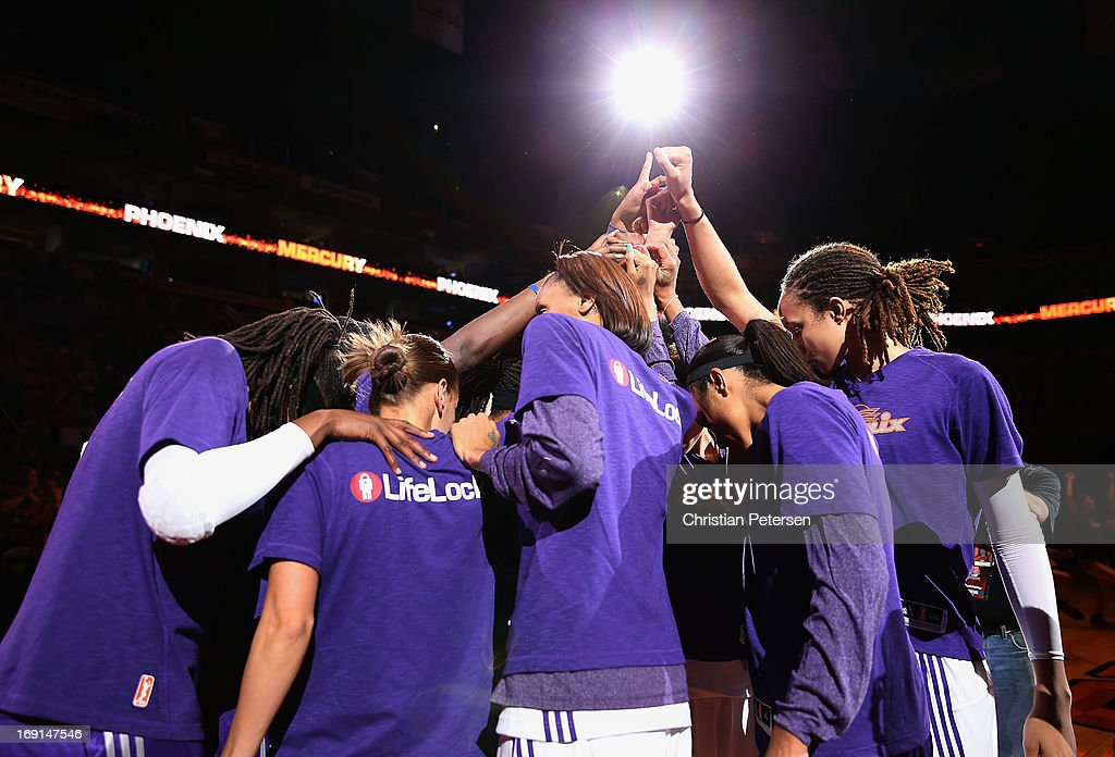 Brittney Griner #42, Candice Dupree #4 and DeWanna Bonner #24 of the Phoenix Mercury huddle up with teammates before the preseason WNBA game against Japan at US Airways Center on May 19, 2013 in Phoenix, Arizona.