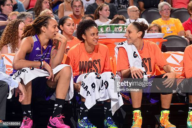 Brittney Griner Candice Dupree and Diana Taurasi of the Western Conference AllStars sit on the bench during the 2014 Boost Mobile WNBA AllStar Game...