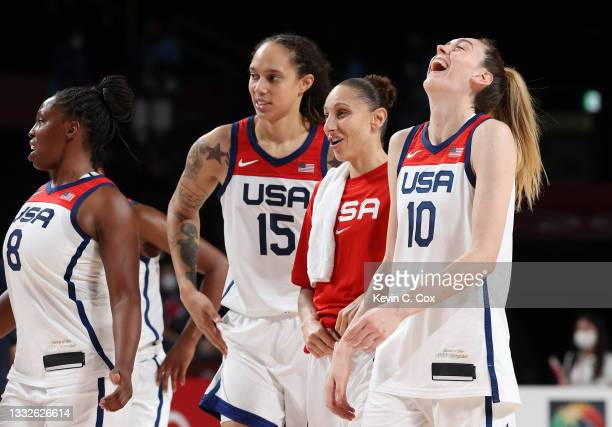 Brittney Griner, Diana Taurasi and Breanna Stewart of Team United States celebrate their victory over Team Serbia in a Women's Basketball Semifinals...