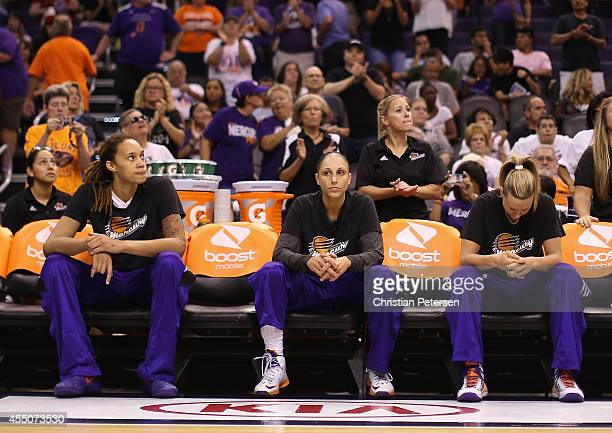 Brittney Griner Diana Taurasi and Penny Taylor of the Phoenix Mercury sit on the bench prior to the start of game two of the WNBA Finals against the...