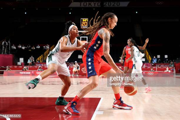 Brittney Griner of Team United States is defended by Pallas Kunaiyi-Akpanah of Team Nigeria during the second half of a Women's Preliminary Round...