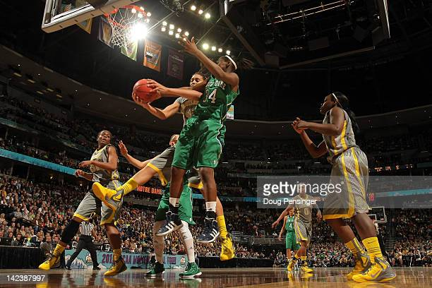 Brittney Griner of the Baylor Bears attempts to control a rebound in the first half against Markisha Wright of the Notre Dame Fighting Irish during...