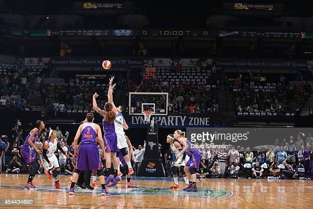 Brittney Griner of the Phoenix Mercury and Janel McCarville of the Minnesota Lynx tipoff during the WNBA Western Conference Finals Game 2 on August...
