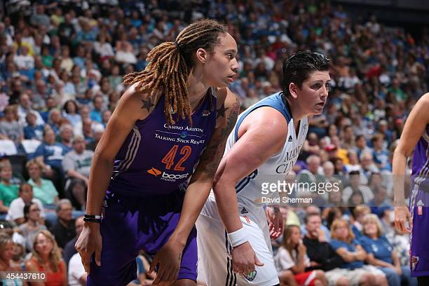 Brittney Griner of the Phoenix Mercury and Janel McCarville of the Minnesota Lynx battle for position during the WNBA Western Conference Finals Game...