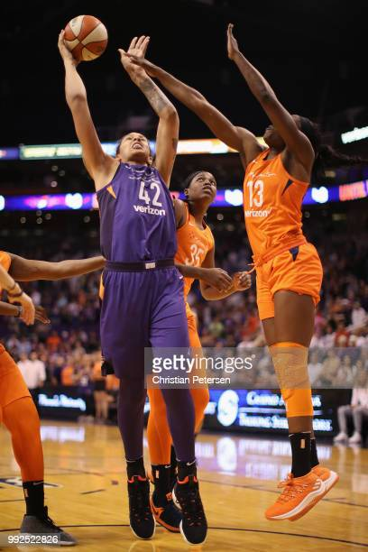 Brittney Griner of the Phoenix Mercury attempts a shot over Chiney Ogwumike of the Connecticut Sun during the first half of WNBA game at Talking...