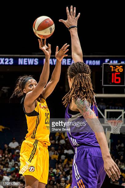 Brittney Griner of the Phoenix Mercury attempts to block a shot by Glory Johnson of the Tulsa Shock during the WNBA game on June 16 2013 at the BOK...