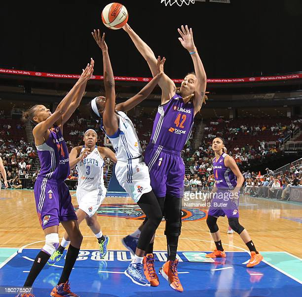 Brittney Griner of the Phoenix Mercury blocks Delisha MiltonJones of the New York Liberty during a game on September 10 2013 at the Prudential Center...