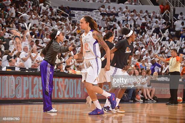 Brittney Griner of the Phoenix Mercury celebrates a play against the Minnesota Lynx in Game 1 of the 2014 WNBA Western Conference Finals on August 29...