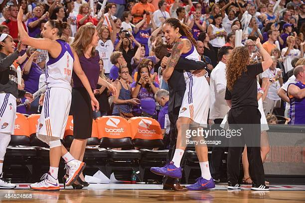 Brittney Griner of the Phoenix Mercury celebrates after winning Game 3 of the 2014 WNBA Western Conference Finals against the Minnesota Lynx on...