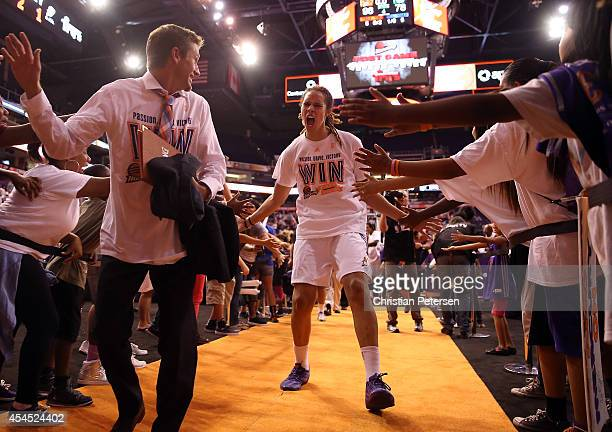 Brittney Griner of the Phoenix Mercury celebrates with fans after defeating the Minnesota Lynx 9678 in game three of the WNBA Western Conference...