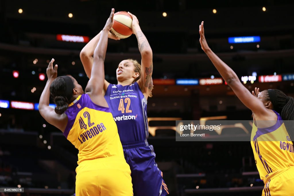 Brittney Griner #42 of the Phoenix Mercury handles the ball against Jantel Lavender #42 and Nneka Ogwumike #30 of the Los Angeles Sparks during a WNBA Playoff Game at Staples Center on September 12, 2017 in Los Angeles, California.