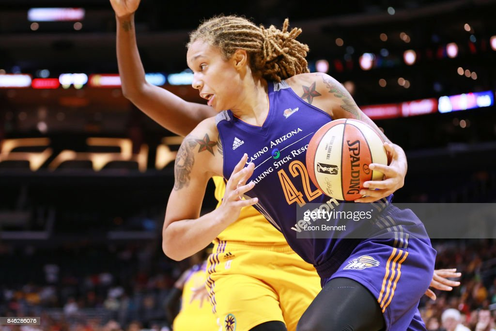 Brittney Griner #42 of the Phoenix Mercury handles the ball against Jantel Lavender #42 of the Los Angeles Sparks during a WNBA Playoff Game at Staples Center on September 12, 2017 in Los Angeles, California.