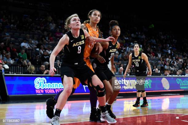 Brittney Griner of the Phoenix Mercury is boxed out by Carolyn Swords and Jaime Nared of the Las Vegas Aces on June 17 2018 at the Mandalay Bay...