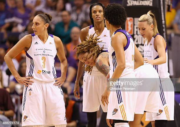 Brittney Griner of the Phoenix Mercury is looked at by Diana Taurasi DeWanna Bonner Candice Dupree and Penny Taylor after receiving a cut above her...