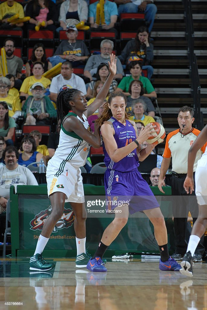 Brittney Griner #42 of the Phoenix Mercury posts up against the Seattle Storm during the game on August 17, 2014 at Key Arena in Seattle, Washington.