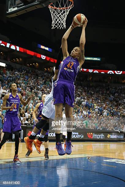 Brittney Griner of the Phoenix Mercury rebounds the ball against Maya Moore of the Minnesota Lynx during the WNBA Western Conference Finals Game 2 on...