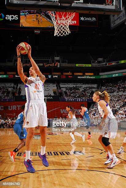 Brittney Griner of the Phoenix Mercury rebounds the ball against the Minnesota Lynx in Game 1 of the 2014 WNBA Western Conference Finals on August 29...