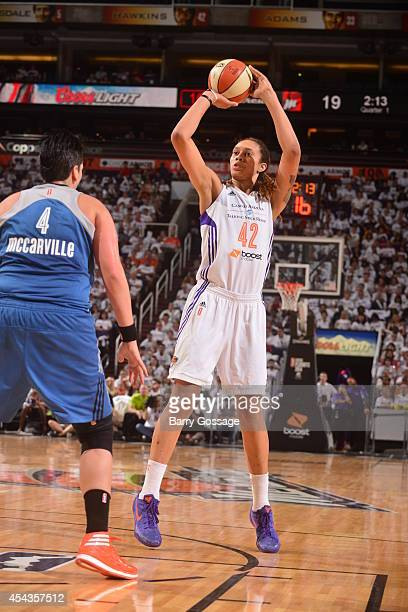 Brittney Griner of the Phoenix Mercury shoots the ball against Janel McCarville of the Minnesota Lynx in Game 1 of the 2014 WNBA Western Conference...