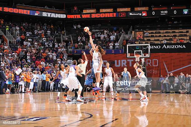 Brittney Griner of the Phoenix Mercury tips off against the Minnesota Lynx in Game 3 of the 2014 WNBA Western Conference Finals on September 2 2014...