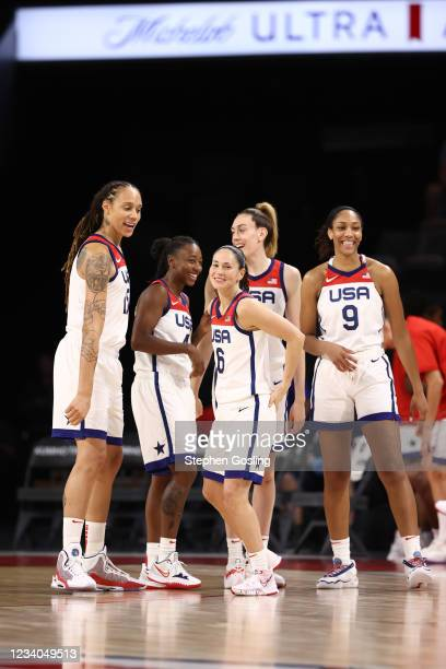 Brittney Griner of the USA Basketball Womens National Team and teammates Jewell Loyd, Sue Bird, Breanna Stewart and A'ja Wilson smile during the game...