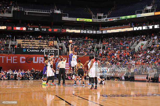 Brittney Griner of the Western Conference AllStars battles for the jump ball against Jessica Breland of the Eastern Conference AllStars during the...