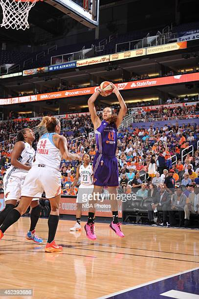 Brittney Griner of the Western Conference AllStars shoots against Erika de Souza of the Eastern Conference AllStars during the 2014 Boost Mobile WNBA...