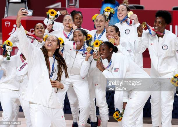 Brittney Griner of USA takes a selfie with teammates during the medal ceremony of the Women's Basketball Gold Medal Final between United States and...