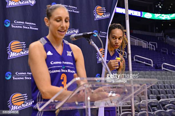 Brittney Griner photo bombs Diana Taurasi of the Phoenix Mercury as she speaks to the media during a press conference on Media Day on May 9 2016 at...