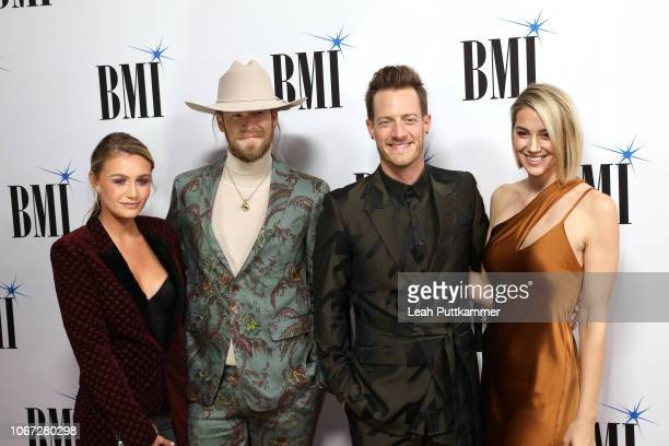 Brittney Kelley Brian Kelley and Tyler Hubbard of Florida Georgia Line and Hayley Hubbard attend the 66th Annual BMI Country Awards at BMI on...