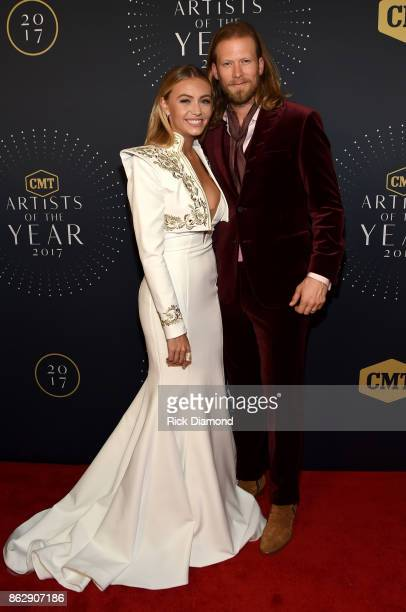 Brittney Marie Cole and Brian Kelley of Florida Georgia Line arrive at the 2017 CMT Artists Of The Year on October 18 2017 in Nashville Tennessee