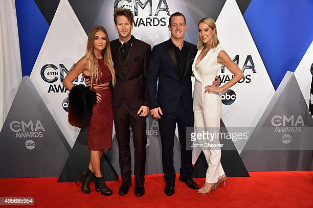 Brittney Marie Cole, Brian Kelley and Tyler Hubbard of Florida Geogia Line, and Hayley Stommel attend the 49th annual CMA Awards at the Bridgestone...