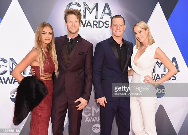 Brittney Marie Cole musicians Brian Kelley Tyler Hubbard of Florida Georgia Line and Hayley Stommel attends the 49th annual CMA Awards at the...