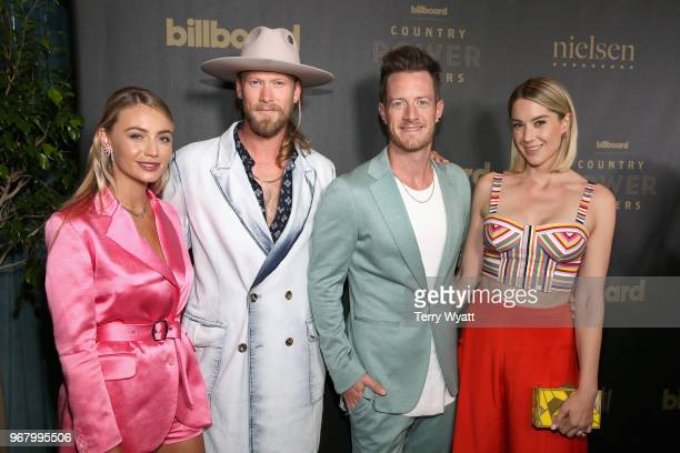 Brittney Marie Cole musicians Brian Kelley Tyler Hubbard of Florida Georgia Line and Hayley Stommelattend as Billboard celebrates the Country Music...